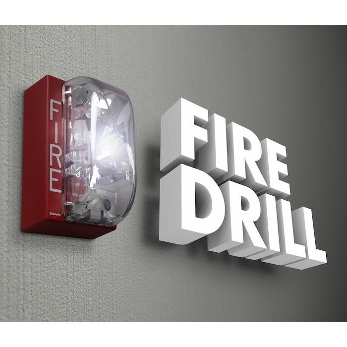 Photo is showing a Fire Alarm mounted to a wal and the words Fire Drill next to it in White